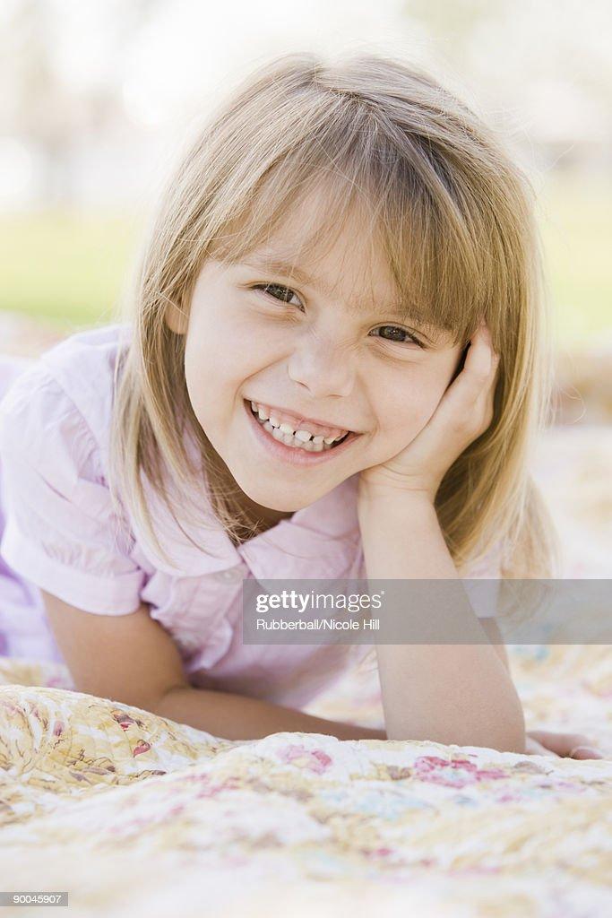 girl lying on a blanket : Stock Photo