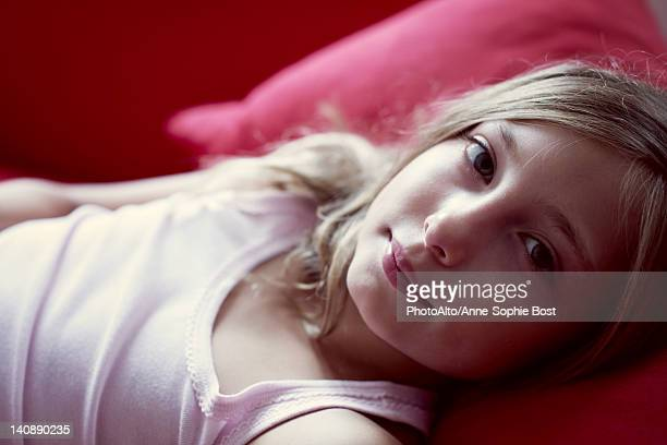Girl lying on couch, portrait