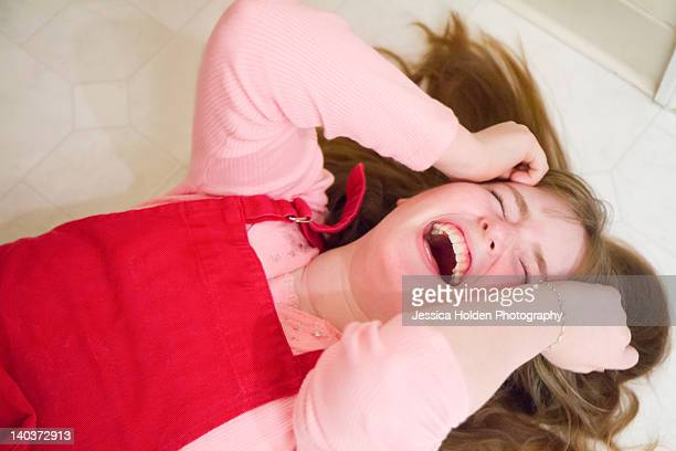 Girl lying on floor and laughing