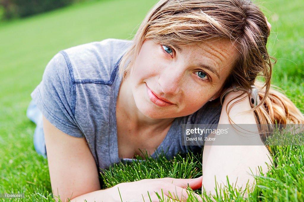 Girl lying on grass : Stock Photo