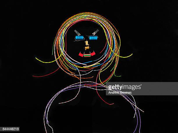 Girl made up of electrical wires and components