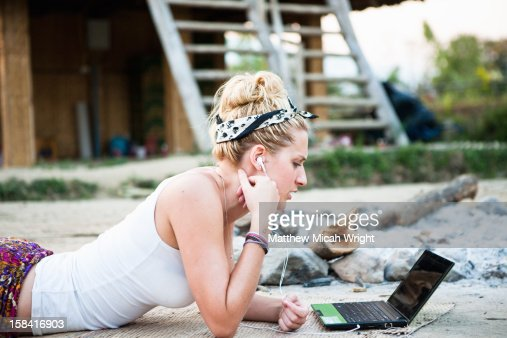 A girl makes an internet call in the outdoors : Stock Photo