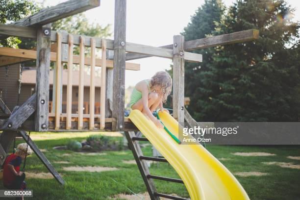 Girl Making a Homemade Water Slide