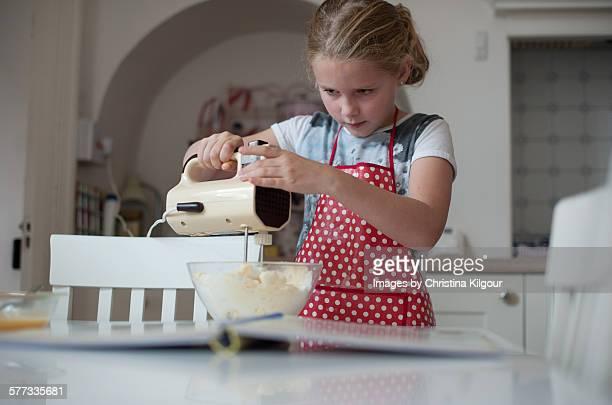 Girl making cakes