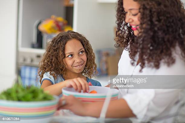 Girl making funny face in kitchen