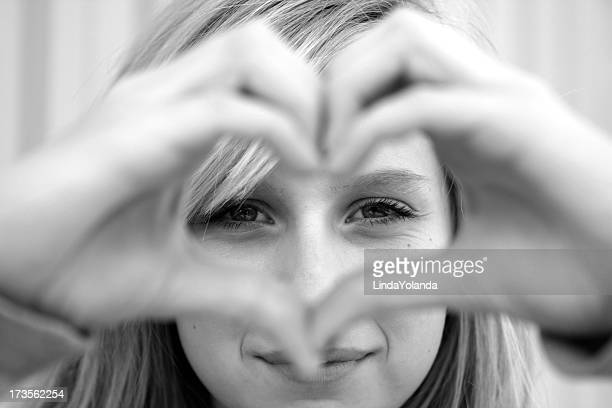 Girl Making Heart Symbol