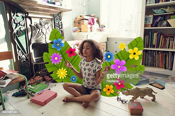 Girl meditating in bedroom with imaginary plants
