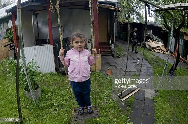 A girl Meri granddaughter of Dusan Podrany and his wife Ludmila stands on a seesaw in the small garden in front of their house on ''Bedriska ''...