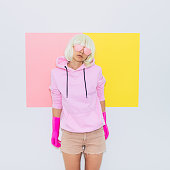 Blonde Girl Model with beauty face in Fashion accessory sunglasses, gloves,  hoodie and shorts. Club DJ Party Fun. Mood and vibes. Minimal unicorn style. Pink and yellow neon colors. 90s or 80s