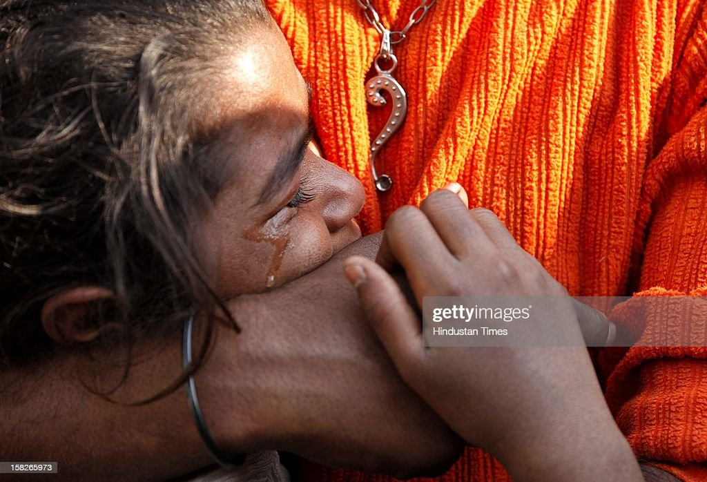 A girl mourns over death of her sister Bulbul and brother Ankit, who died after a wall collapsed at Dallupura village near New Ashok Nagar on December 12, 2012 in New Delhi, India. 5 children died and one got seriously injured in the incident.