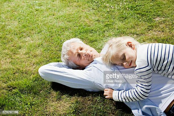 Girl napping with grandfather