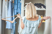 girl near the wardrobe with clothes chooses what to wear Nothing To Wear Design