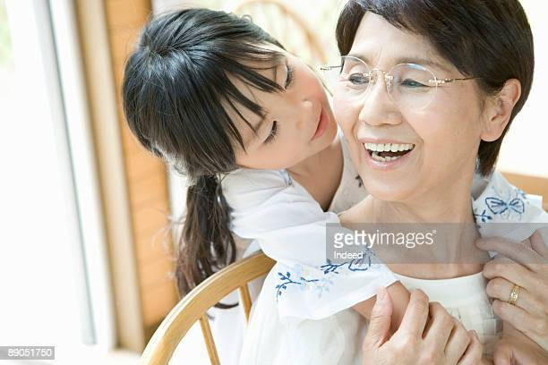 Girl nestling up to her grandmother