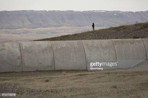 A girl observes one of two vacuum chambers measuring four kilometers in length during a public tour of the Laser Interferometer GravitationalWave...