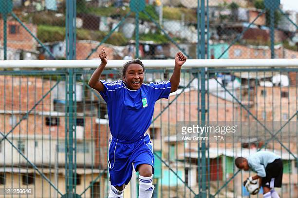 A girl of Bogota celebrates a goal during an exhibition match between the local Football for Hope groups of Cali and Bogota at Ciudad Bolivar...