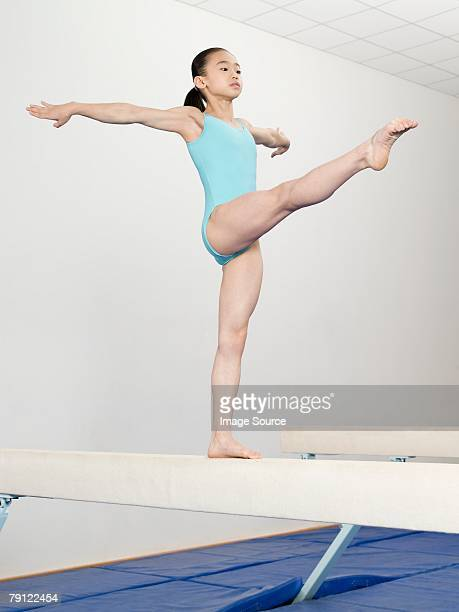 Girl on a balance beam