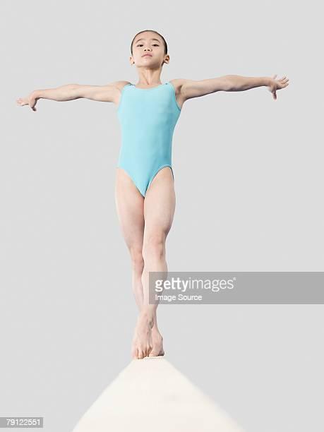 Girl on a balance beam