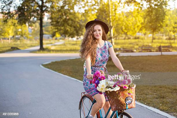 Girl on a bicycle on autumn morning