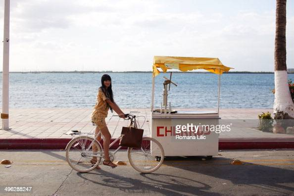 Girl on a bike next to a churros stand in malecon de La Paz Baja California Sur Mexico
