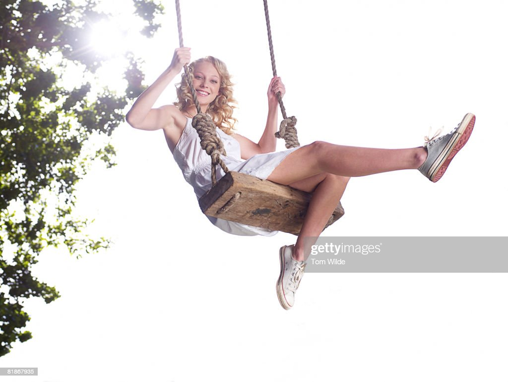 Girl on a swing : Stock Photo