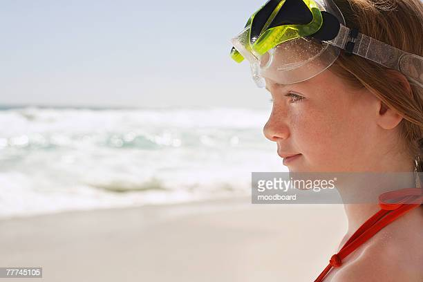Girl on Beach Wearing Diving Goggles