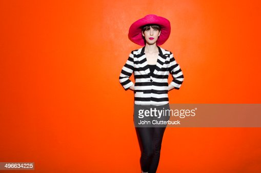 Girl on bright orange background