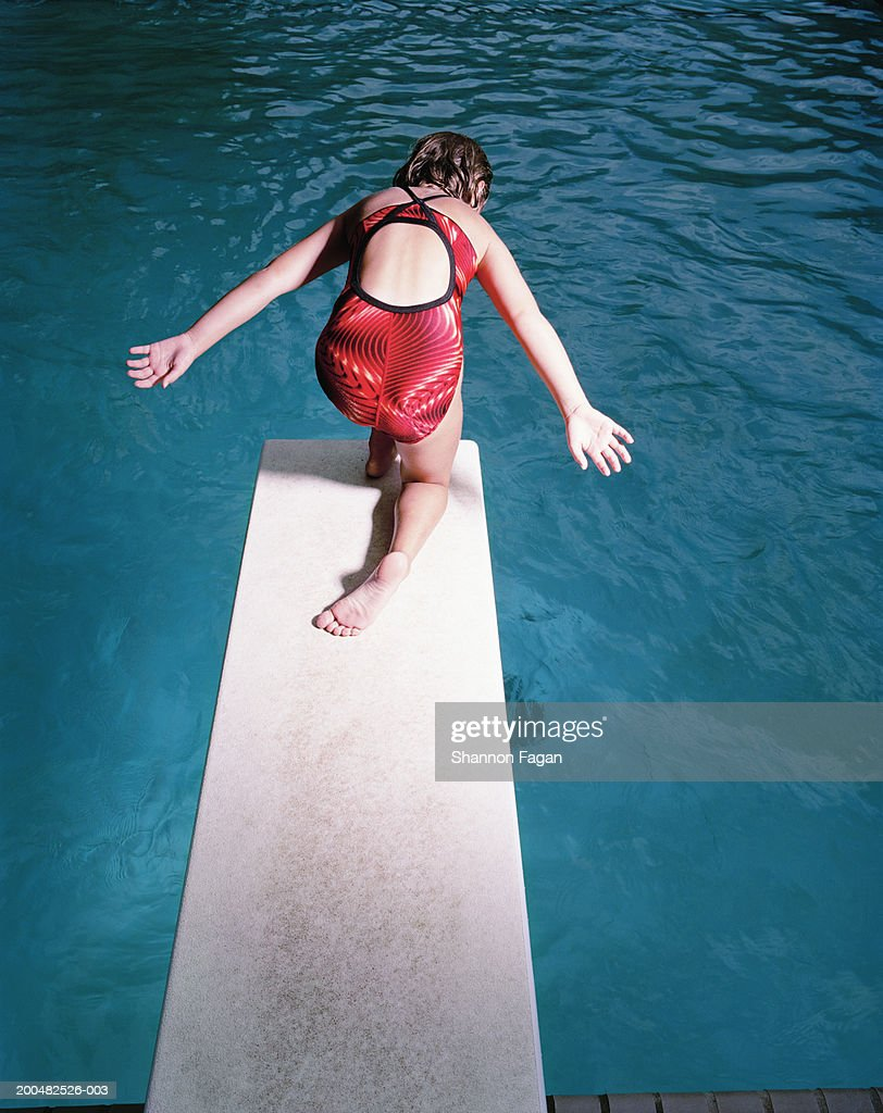 Girl On Diving Board At Swimming Pool Stock Photo Getty Images