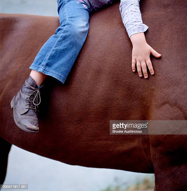 Girl (4-6) on horse, low section