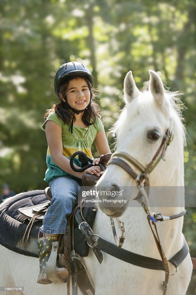Girl on horse : Stock Photo