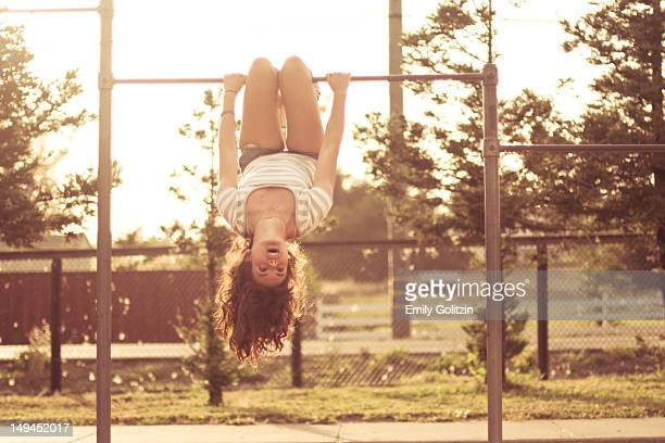 Girl on monkey bars