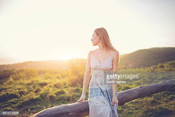 Girl on mountain sunset