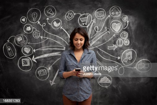 Girl on phone with social media chalkboard