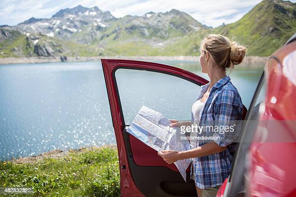 Girl on road trip consulting map-Summer
