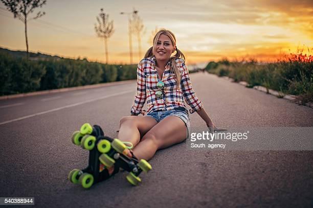 Girl on roller skates in sunset