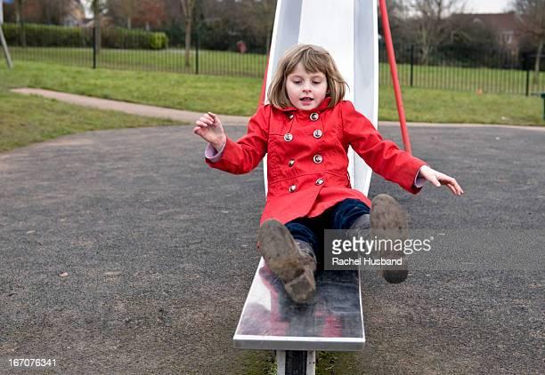 Girl on slide in park