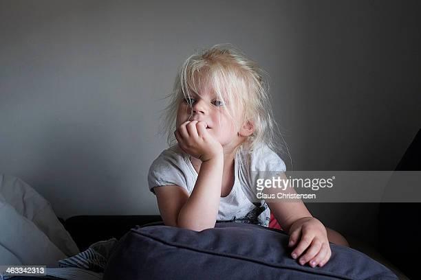 Girl on sofa watching tv.