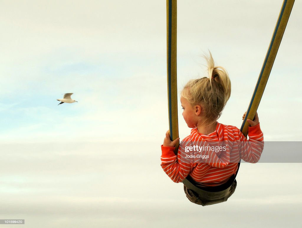 Girl on Swing, Looking at Bird Flying Past