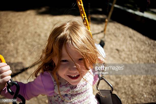 girl (4yrs) on swingset