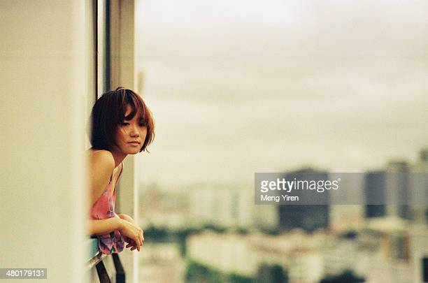 Girl on the balcony with city view