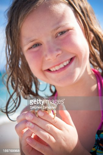 girl on the beach with hermit crab : Stock Photo