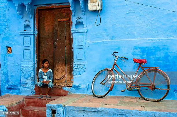 CONTENT] A girl on the doorstep of her house in Jodhpur Rajasthan