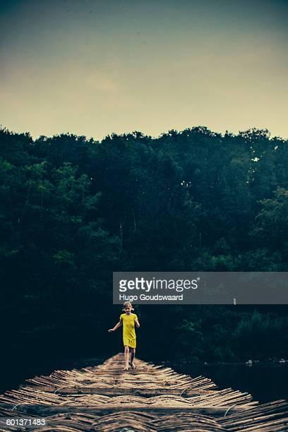Girl on wooden bridge