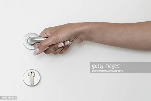 Girl opening a white door