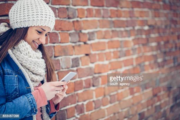 Girl outdoors texting