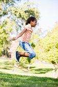 Girl outside using skipping rope