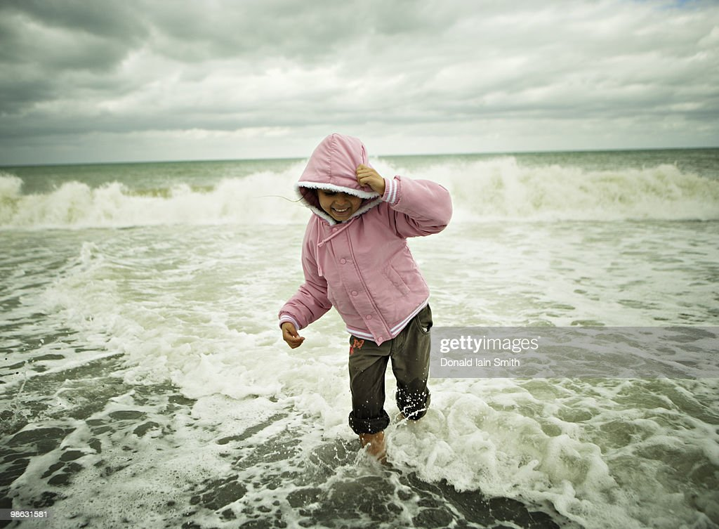Girl paddles in Pacific Ocean : Stock Photo