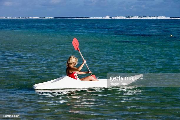Girl paddling kayak at M??venpick Resort and Spa.