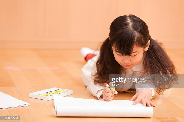 Girl Painting on Floor