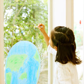 Girl Painting On Window Glass