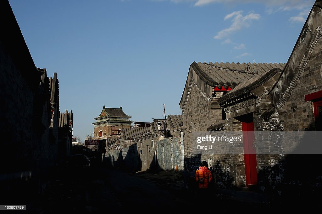 A girl passes through an alley near Bell Tower on February 6, 2013 in Beijing, China.
